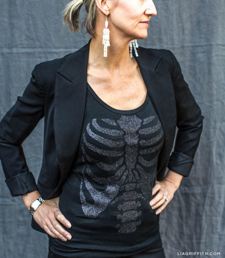 Women wearing DIY skeleton top and DIY skeleton earrings for Halloween