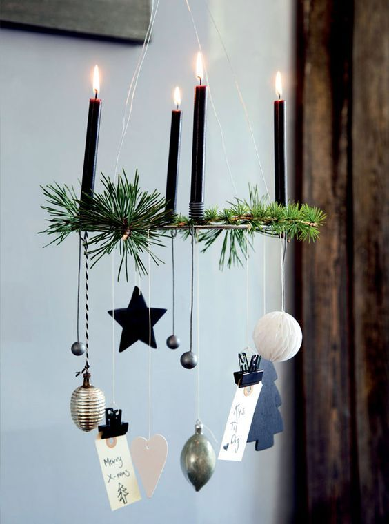 Wreath with hanging ornaments and candles