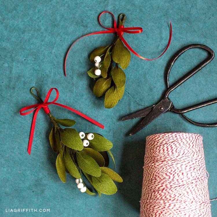 DIY crepe paper mistletoe next to scissors and twine