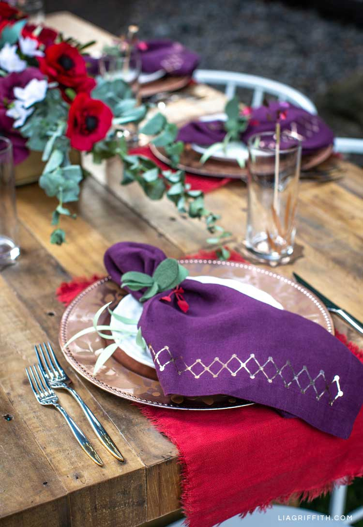 holiday tablescape with DIY place settings, paper plants, and paper flowers
