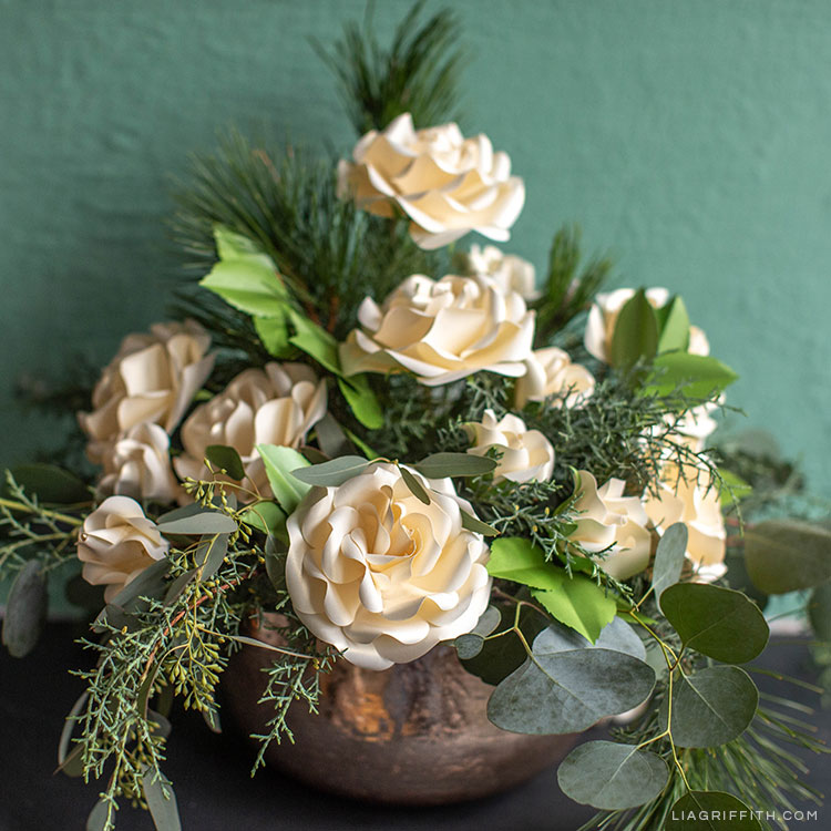 pearly off-white Ecuadorian roses and fresh greenery arrangement