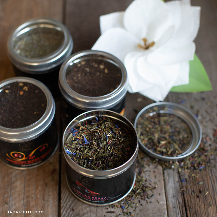 Signature RESERVE loose-leaf tea and white paper poinsettia for holiday gift basket