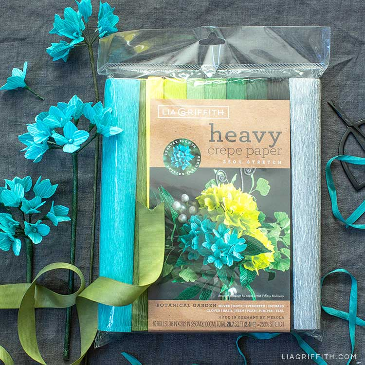 Botanical Garden heavy crepe paper by Lia Griffith with teal crepe paper hydrangea flowers and green ribbon