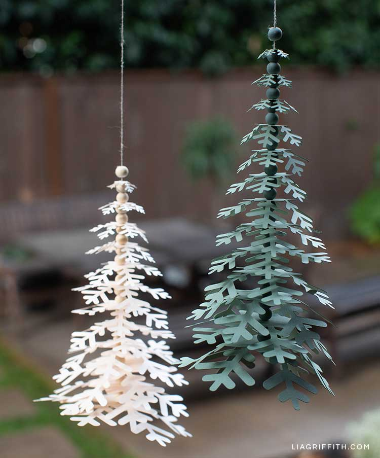 paper snowflake trees hanging on twine