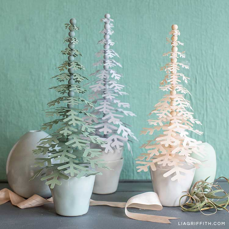 paper snowflake trees in tiny pots on mantel