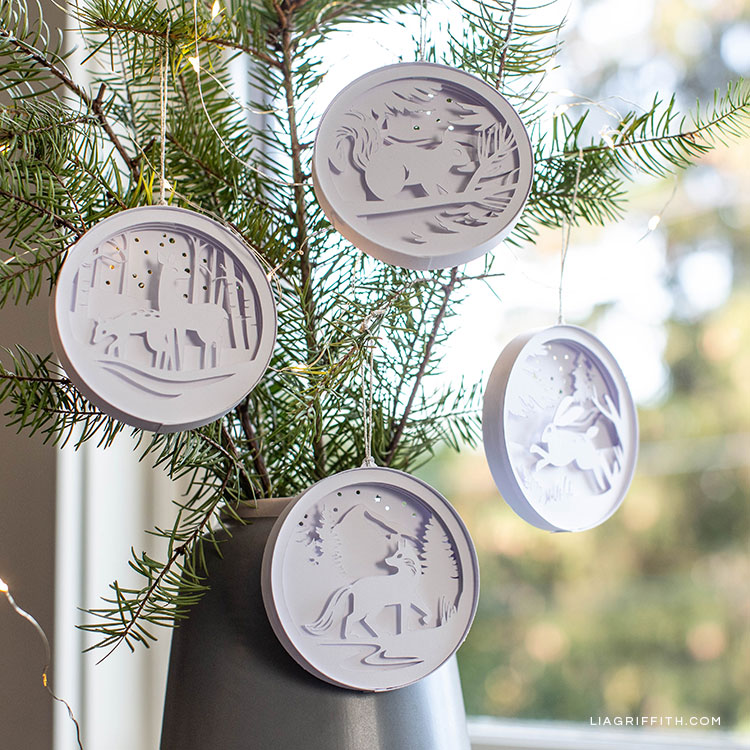 3D paper woodland ornaments hanging on little Christmas tree in pot
