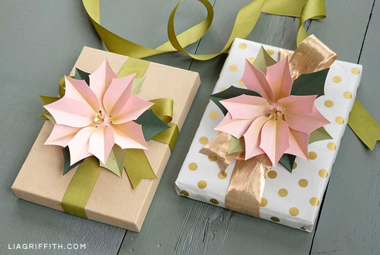 pink frosted paper poinsettias as gift toppers