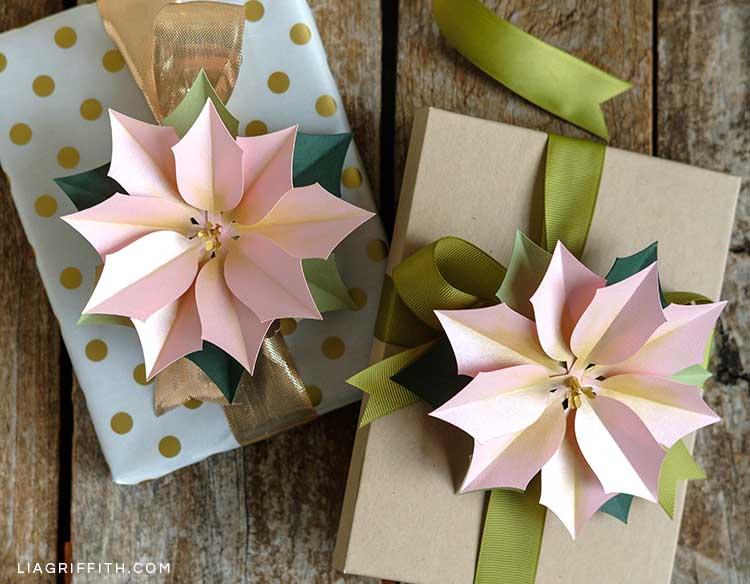 pink frosted paper poinsettias on gifts