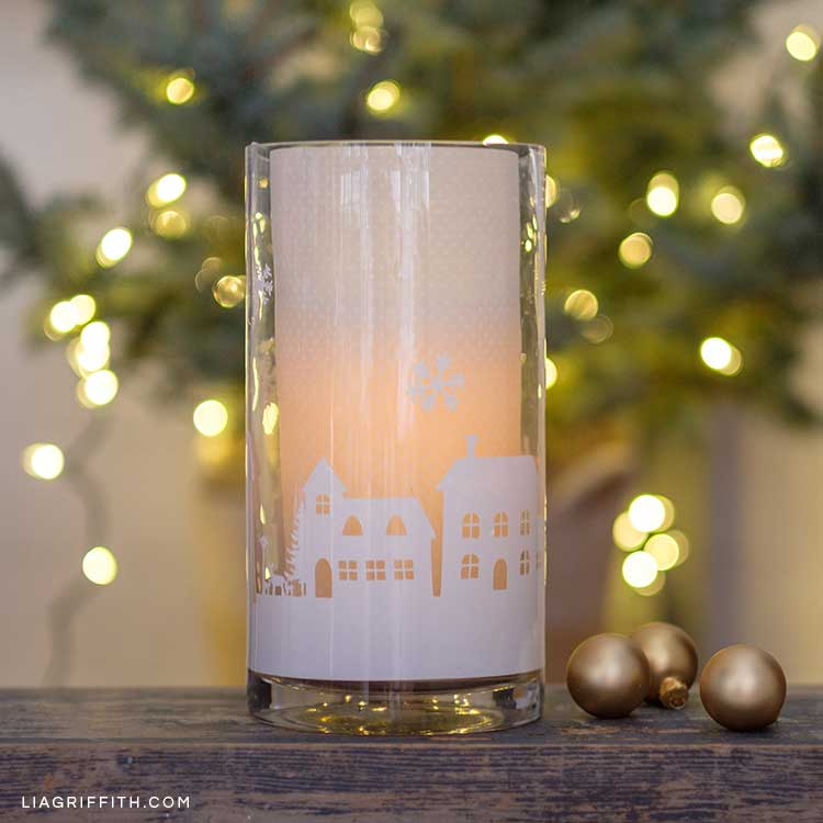 Winter hurricane candle lantern décor with paper houses