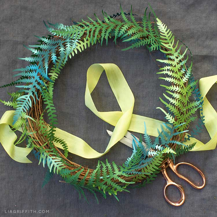 DIY paper fern wreath with ribbon and scissors