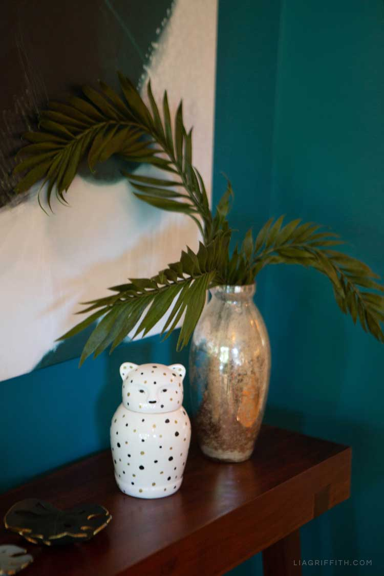 Paper plant in vase on shelf