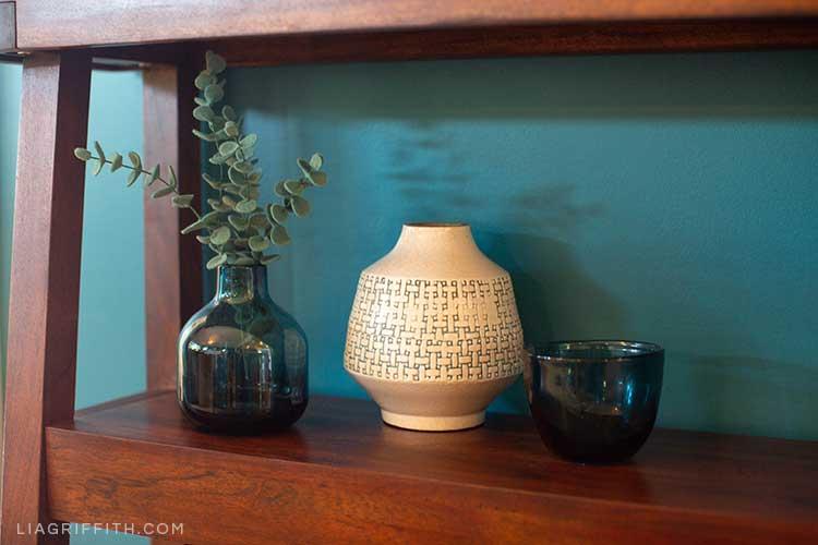 shelf with vases and felt eucalyptus sprigs