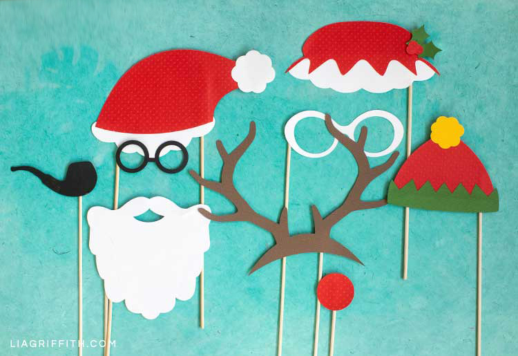 Santa, Mrs. Claus, elf, and reindeer photo booth props for Christmas party