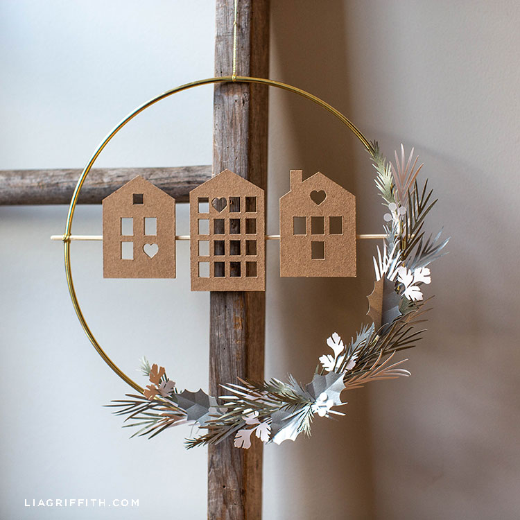 DIY Scandi house and greenery wreath hanging on wooden ladder