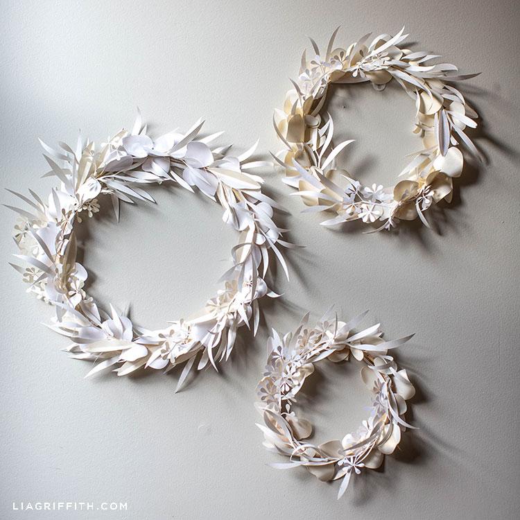 white paper eucalyptus wreaths on white wall