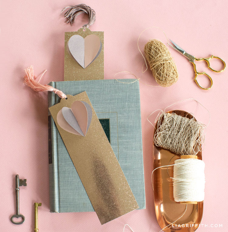 3D paper heart bookmarks with book, twine, keys, and scissors