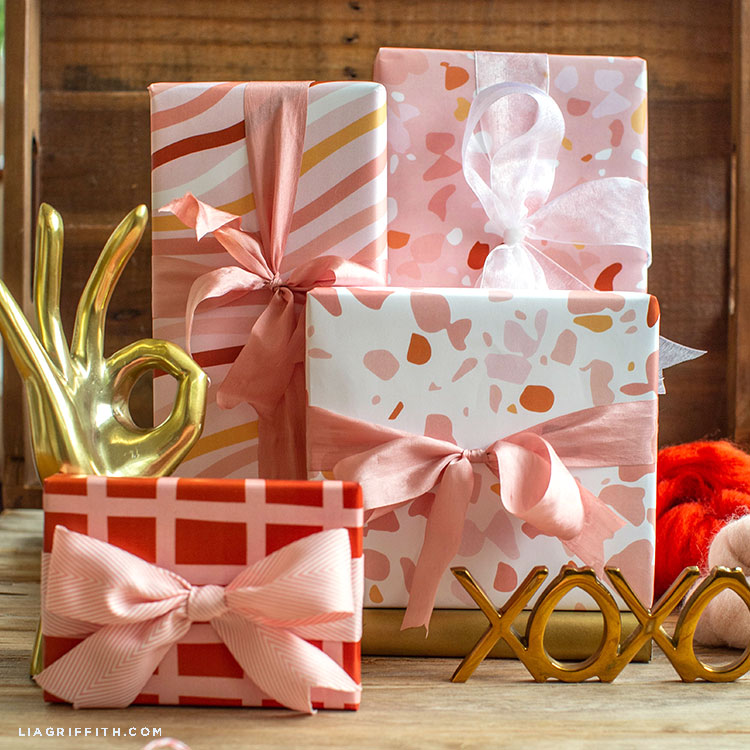 terrazzo Valentine's Day gift wrap with gold XOXO sign and gold hand decor