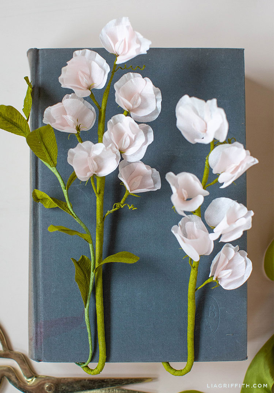 crepe paper sweet peas on book