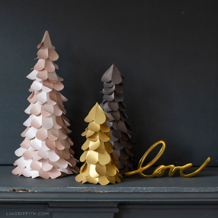 paper heart trees in pink, gold, and grey on grey mantel with gold love sign