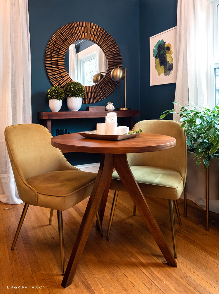 corner of living room with small table and two chairs