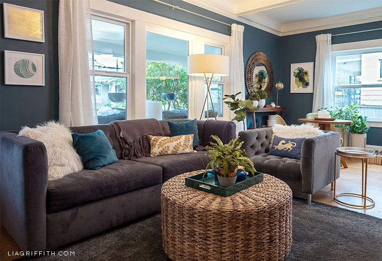 living room with couch and round wicker table