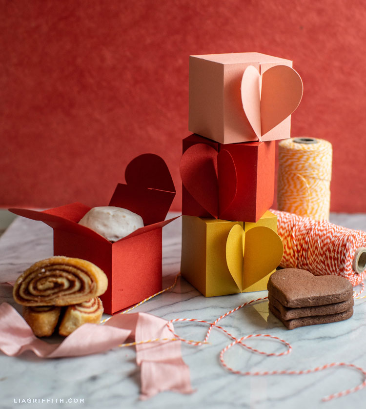 paper heart treat boxes with cookies and twine