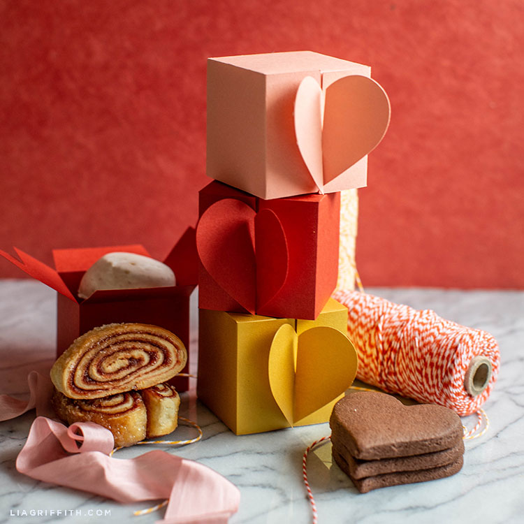 paper heart treat boxes with cookies, ribbon, and twine