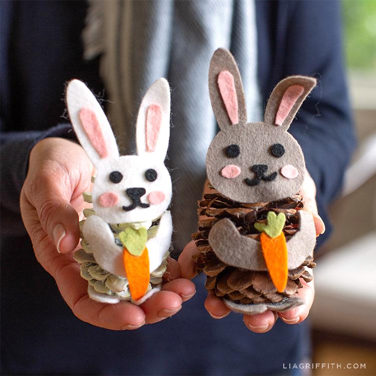 Hands holding felt pinecone bunnies