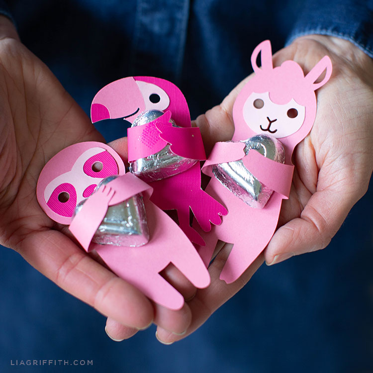 Person holding pink animal candy huggers with chocolate hearts