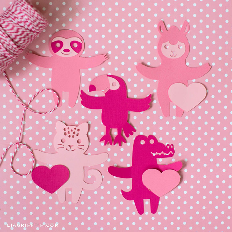 pink animal candy huggers and twine on pink and white polka-dot background