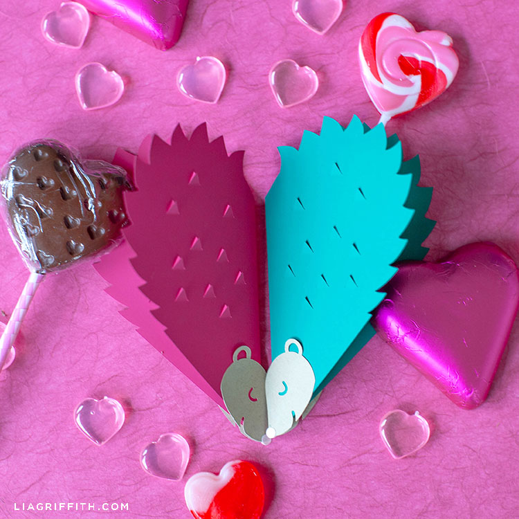pink and emerald papercut hedgehog valentines with heart-shaped candy