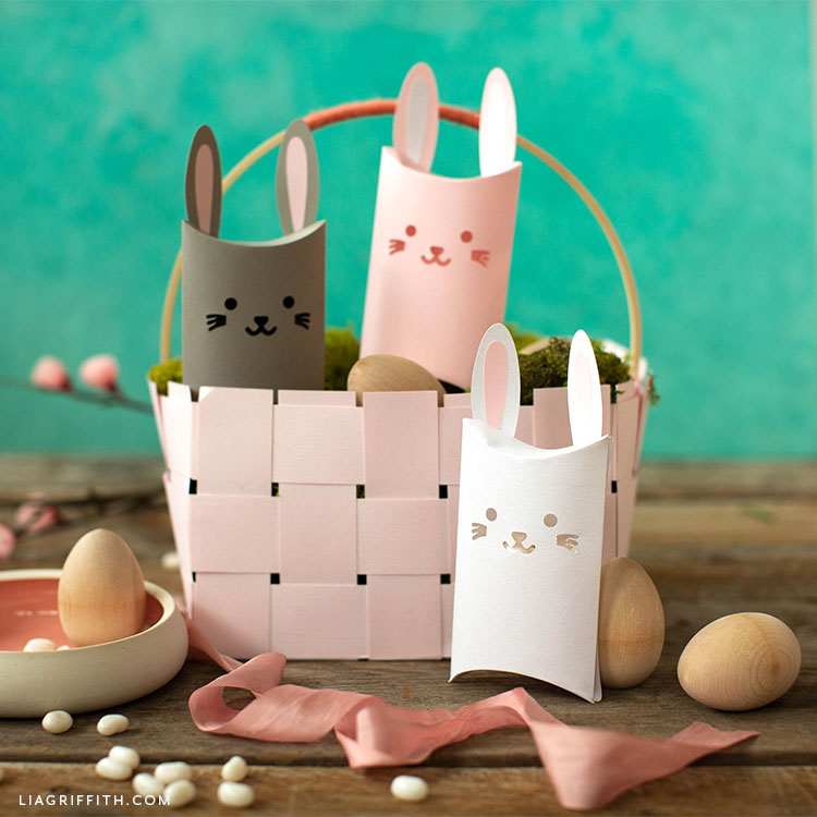 papercut bunny pillow boxes in Easter basket with wooden eggs and pink ribbon