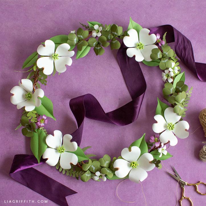 paper shamrock and dogwood wreath with purple ribbon
