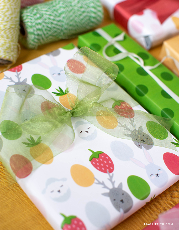 Easter gift wrap with green bow and twine in background