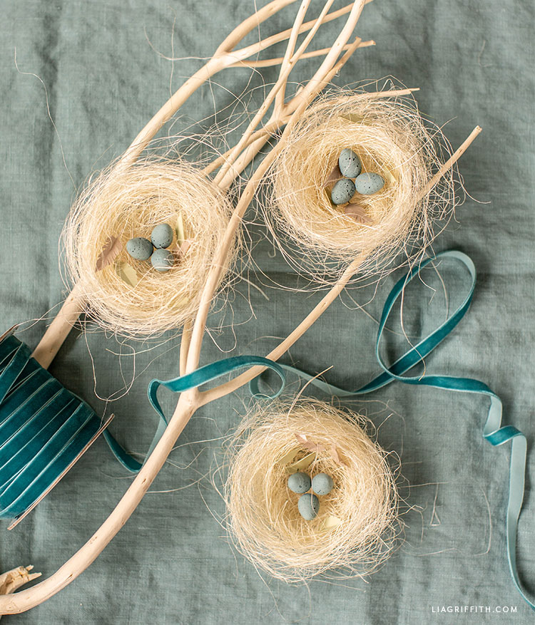 three robin's nests made of natural sisal with spun cotton robin eggs