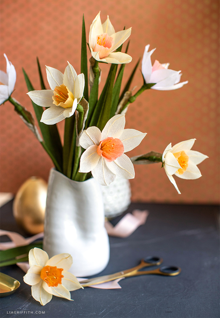 extra fine crepe paper daffodils in white vase