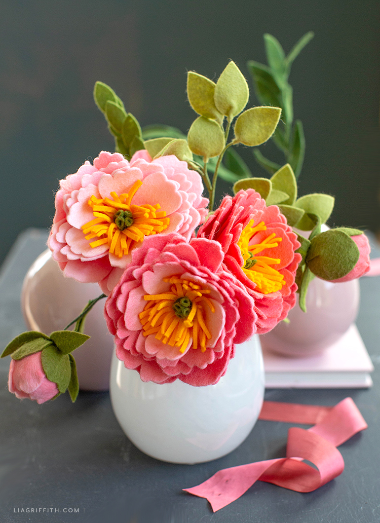 felt coral charm peony flowers and buds with felt leaves in white vase
