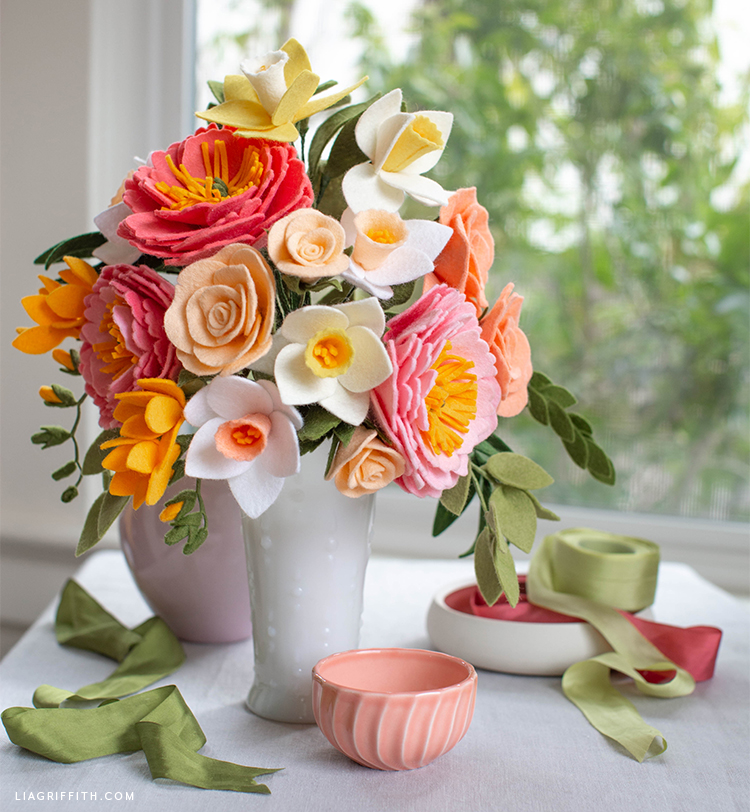 felt flower bouquet in vase on top of table near window