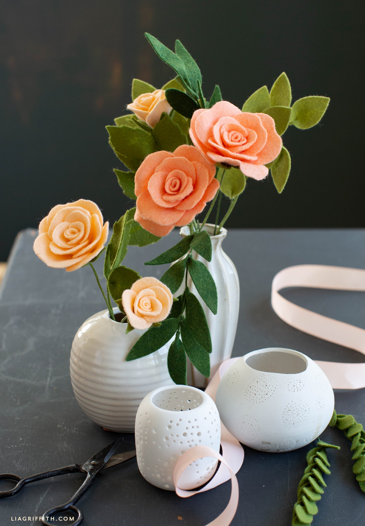 felt tea roses and buds with leaves in white vase