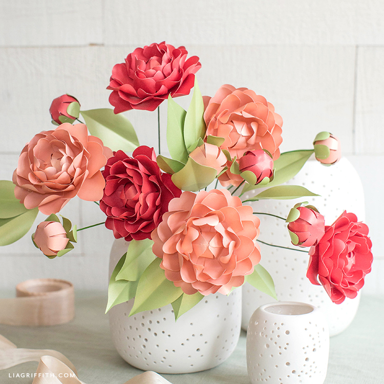 pink and red frosted paper camellias in white vase