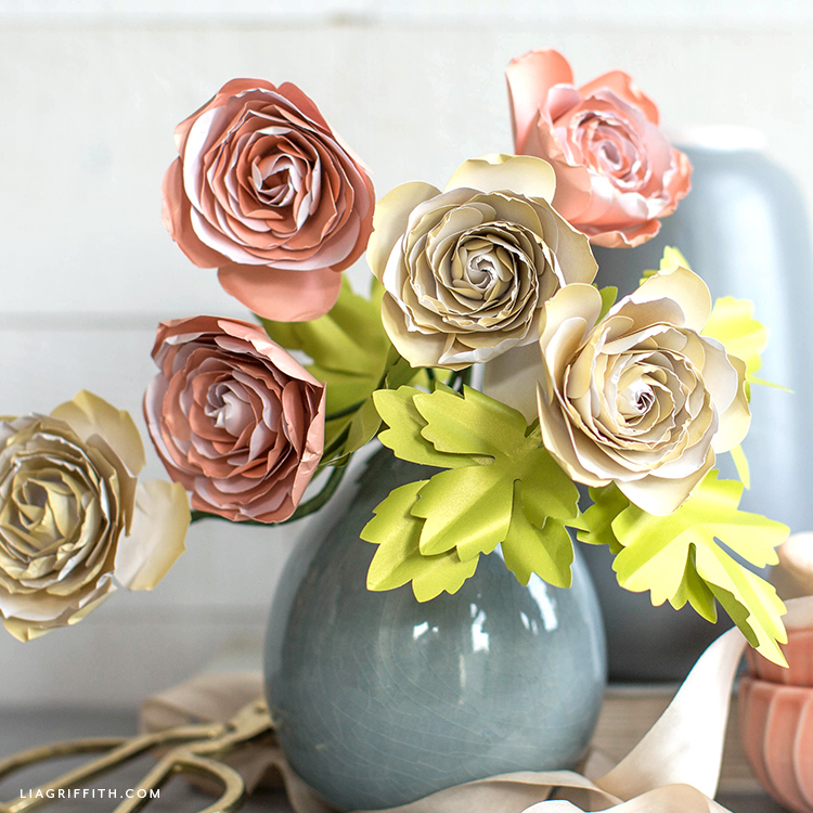 frosted paper ranunculus in grey vase