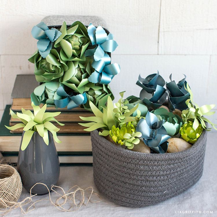 frosted paper succulent arrangements in woven baskets and vase