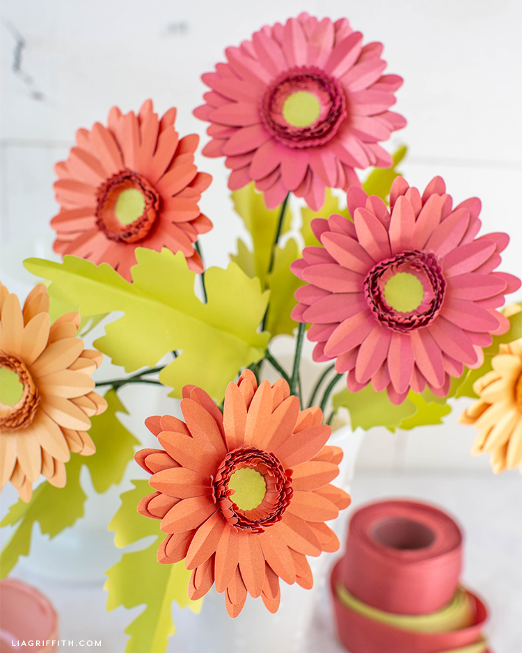 frosted paper daisies with leaves