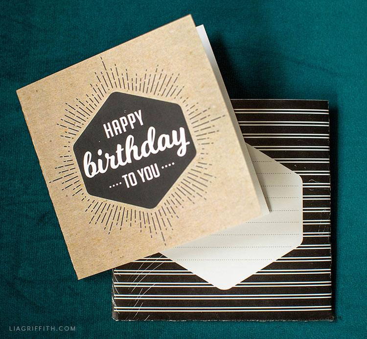 Kraft happy birthday card with striped sleeve