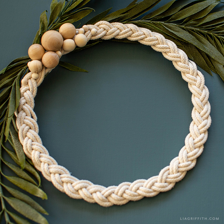 braided rope wreath with wooden beads and crepe paper palm fronds