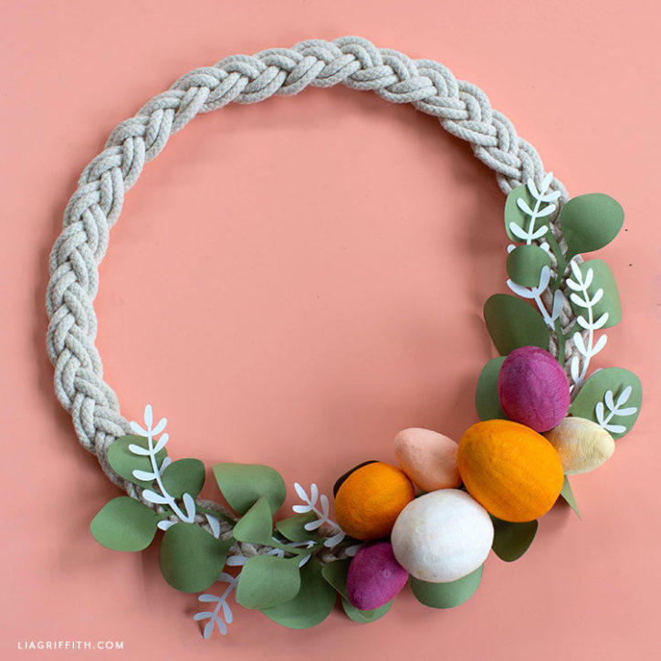 handmade Easter wreath with paper greenery and crepe paper covered cotton spun eggs