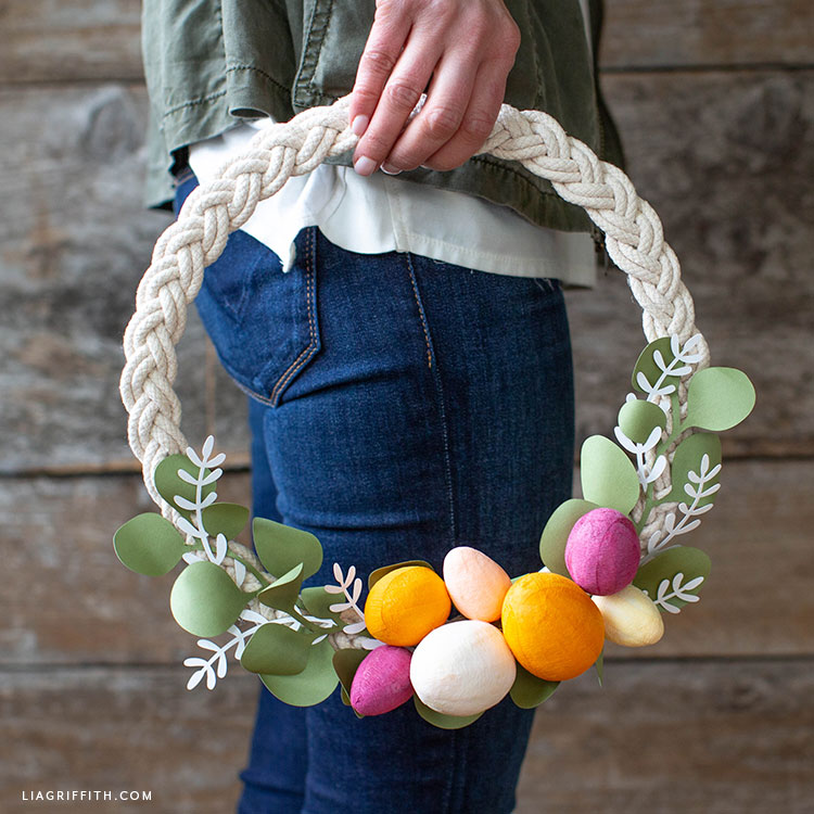 Woman holding handmade Easter wreath