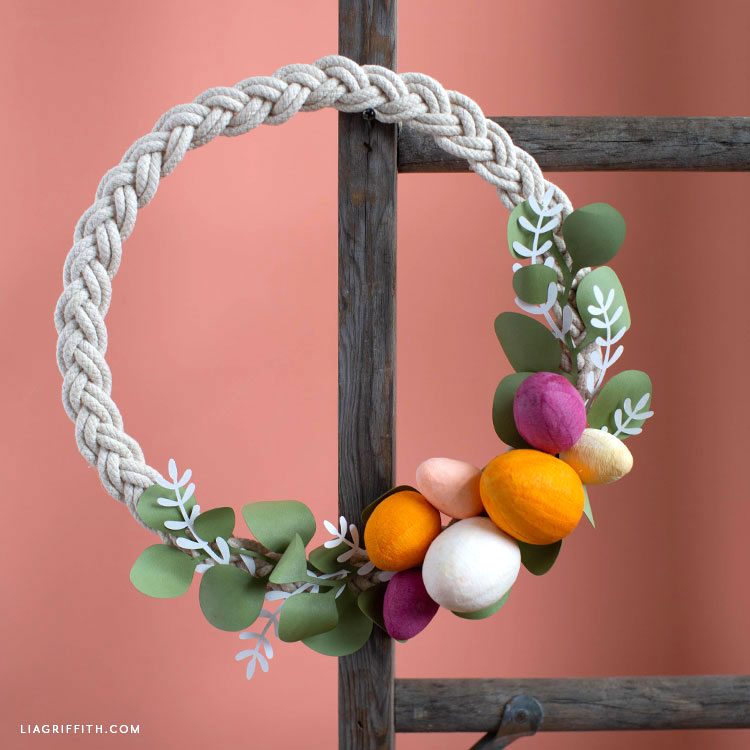 handmade Easter wreath hanging on wood ladder