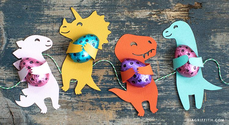 dinosaur candy huggers holding chocolates