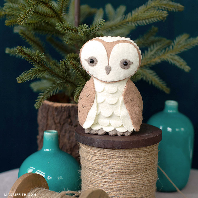 felt barn owl stuffie on spool of twine by little tree